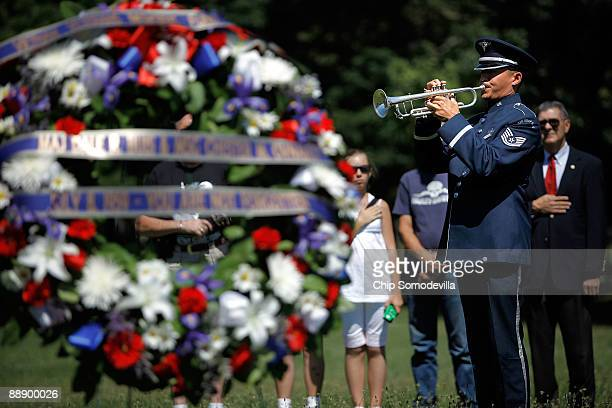 S Air Force Tech Sgt Mike Ramos plays Taps on the trumpet during a ceremony commemorating the 50th anniversary of the first two American combat...