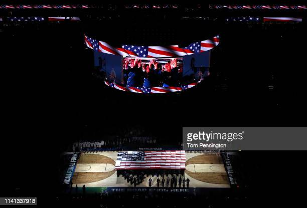 Air Force technical sergeant Johnny Holliday performs the national anthem prior to the 2019 NCAA men's Final Four National Championship game between...
