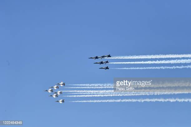 Air Force Thunderbirds and U.S. Navy Blue Angels perform a flyover tribute during the COVID-19 pandemic on May 02, 2020 in Atlanta, Georgia. The Blue...