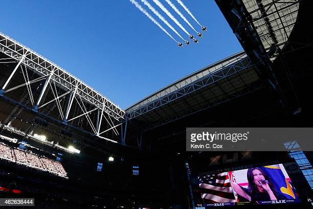 Air Force Thunderbirds fly over the stadium prior to Super Bowl XLIX between Seattle Seahawks and New England Patriots at University of Phoenix...