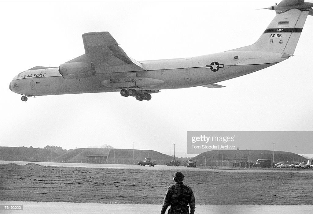 Air Force transport plane landing with the first delivery of cruise missiles at RAF Greenham Common near Newbury in Berkshire, 14th November 1983. The airbase was the site of large-scale protests by anti-nuclear campaigners opposed to the deployment of the missiles.
