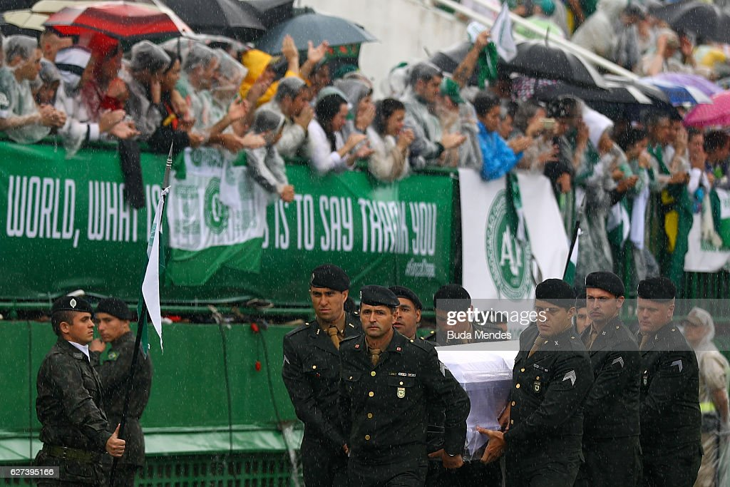 Air Force troops carry coffin of one of the victims of the plane crash in Colombia at the Arena Conda stadium on December 03, 2016 in Chapeco, Brazil. Players of the Chapecoense soccer team were among the 77 people on board the doomed flight that crashed into mountains in northwestern Colombia. Officials said just six people were thought to have survived, including three of the players. Chapecoense had risen from obscurity to make it to the Copa Sudamericana finals against Atletico Nacional of Colombia.