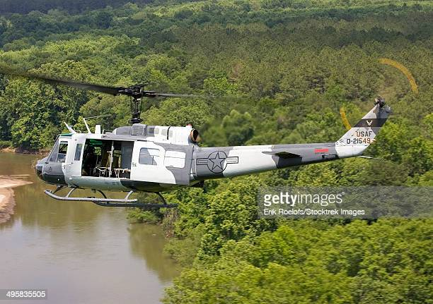 A U.S. Air Force UH-1H Huey in an experiment paint scheme.