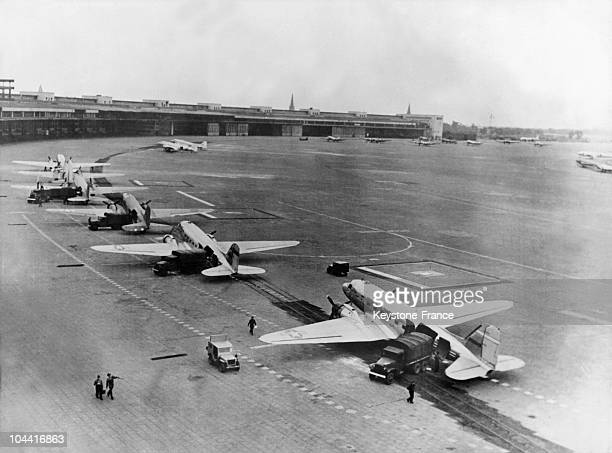 S Air Force unloading at Tempelhof airfield in Berlin their cargoes of food and other supplies for the inhabitants of Berlin isolated by the embargo...