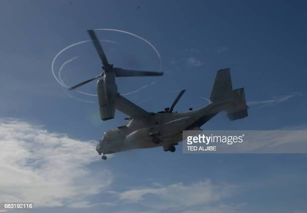 A US air force V22 Osprey aircraft prepares to land during a simulation of a disaster drill as part of the annual joint PhilippinesUS military...