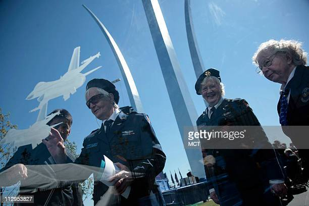 Air Force veterans FG Reynolds Elaine Harmon and Barbara Squire look through a glass panel of the missing man formation at the opening ceremony of...
