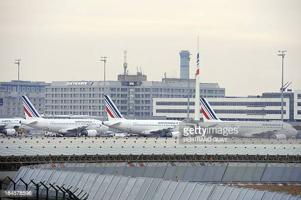 Air France aircrafts are parked on February 7 2012 at the Paris international airport of RoissyCharles de Gaulle Flights were cancelled today on the...