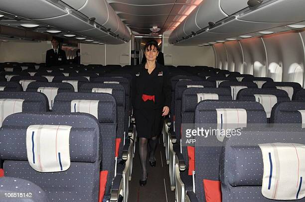 Air France crew member walks in the economoy class onboard the new Airbus A380 superjumbo passenger jet as it Air France crew member walks in the...