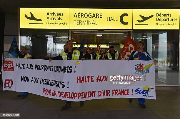 Air France employees protest against a restructuring plan that will cut hundreds of jobs next year on October 22 2015 at ToulouseBlagnac airport in...