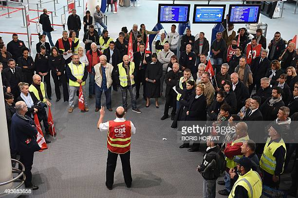 Air France employees protest against a restructuring plan that will cut hundreds of jobs next year on October 22 2015 at Marignane airport near...
