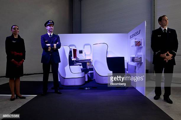 Air France flight crew stand beside a new business class seat unit during a presentation of new aircraft seats for the airline at the Zodiac Seats...
