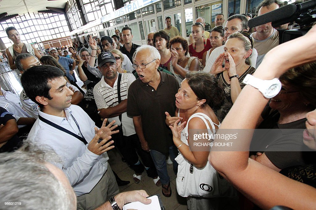 Air France passengers argue at Gillot airport in the French Indian ocean island of Saint Denis de la Reunion on April 22, 2010. Two thousand and five hundred passengers are stuck after Air France national company didn't charter enough planes as traffic air returned to normal. Nearly seven million passengers have been affected in the world by the disruption of air traffic due to the volcano eruption in Iceland.