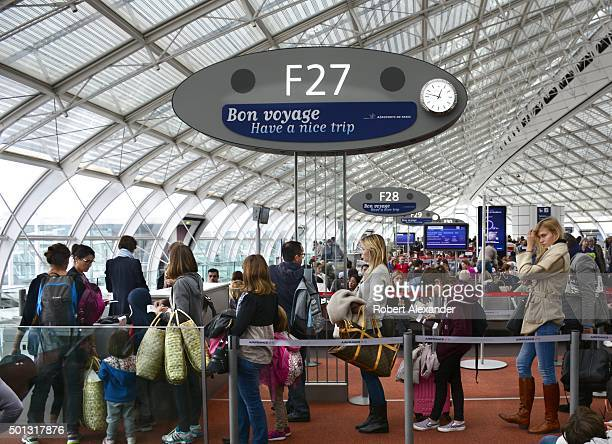 Air France passengers line up to board their plane at Charles de Gaulle Airport in Paris France