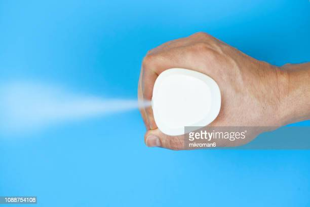Air freshener. Hand spraying air freshener
