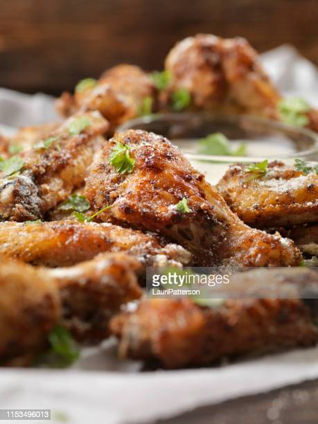 air fried, garlic/parmesan crispy chicken wings with ranch dip - chicken wings stock pictures, royalty-free photos & images