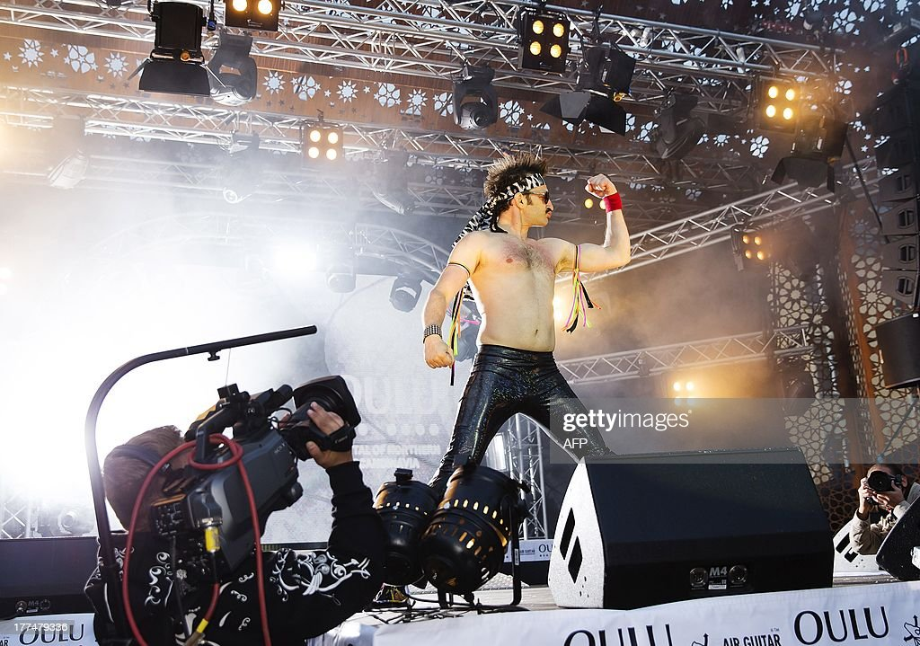 US air guitarist Runner-up Doug 'The Thunder' Stroock performs during the 2013 Air Guitar World Championships in Oulu, Finland on August 23, 2013. AFP PHOTO / Lehtikuva/TIMO