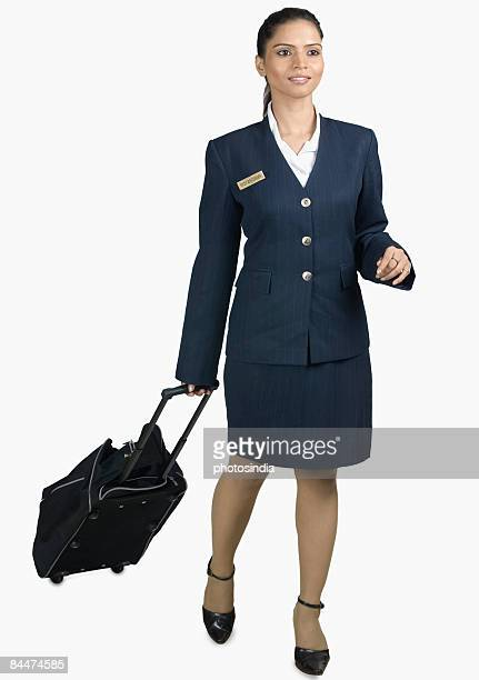 Air hostess carrying her luggage