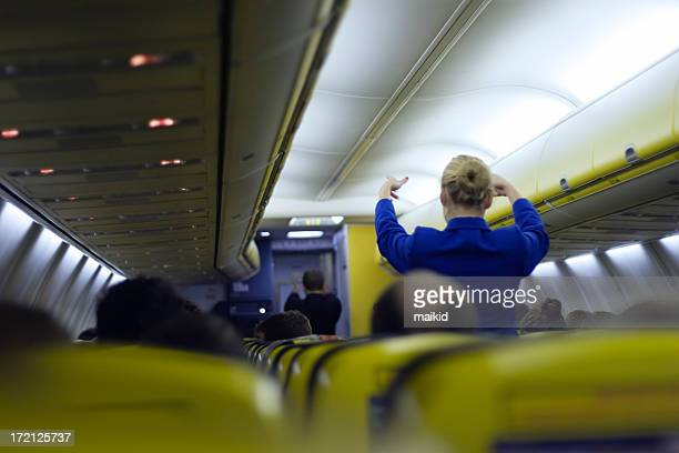 air hostess giving instructions