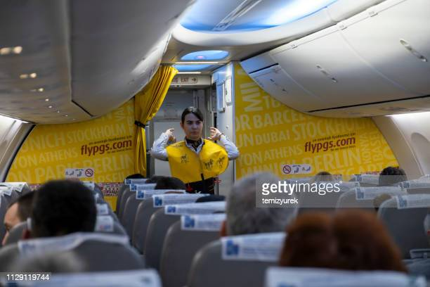 air hostess giving safety instructions before flight - instructions stock pictures, royalty-free photos & images