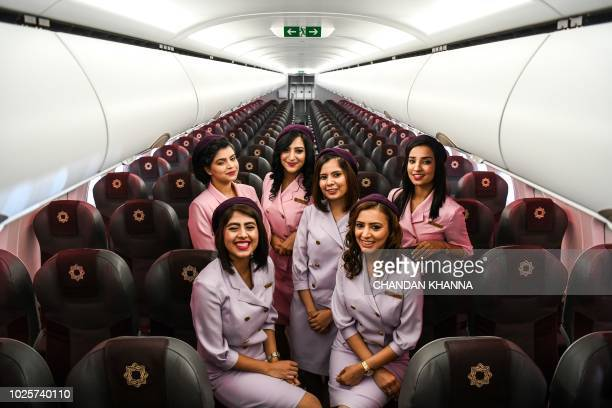 Air hostess of Vistara's new Airbus A320neo pose during an event at the Indira Gandhi International Airport in New Delhi on September 1 2018...