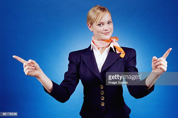 Air hostess pointing