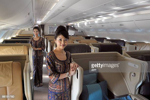 Air hostess pose in the business class equipped with single beds in an Airbus A380on June 2 2009 in RoissyenFrance northern suburb of Paris after the...