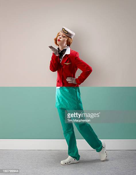 air hostess top, surgeon bottom - crew stock pictures, royalty-free photos & images