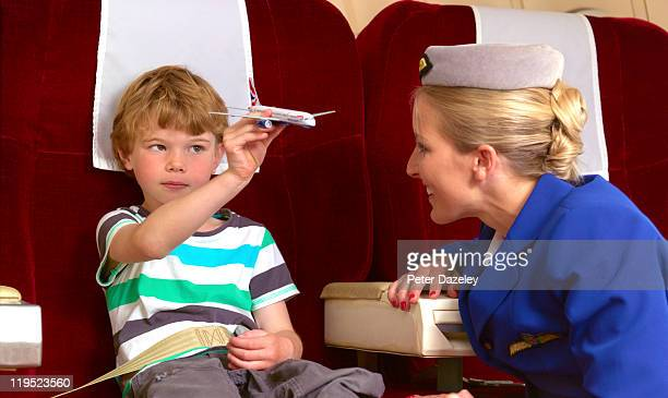 Air hostess with child on plane