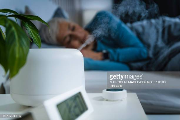 air humidifier in bedroom - sleeping stock pictures, royalty-free photos & images