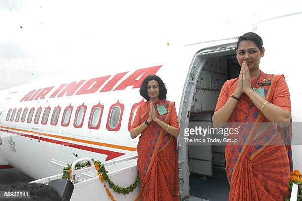 Air India air hostesses in their new uniform atop the Air India flight during the delivery of the Boeing 737800 VTAXH to its own fleet at Indira...