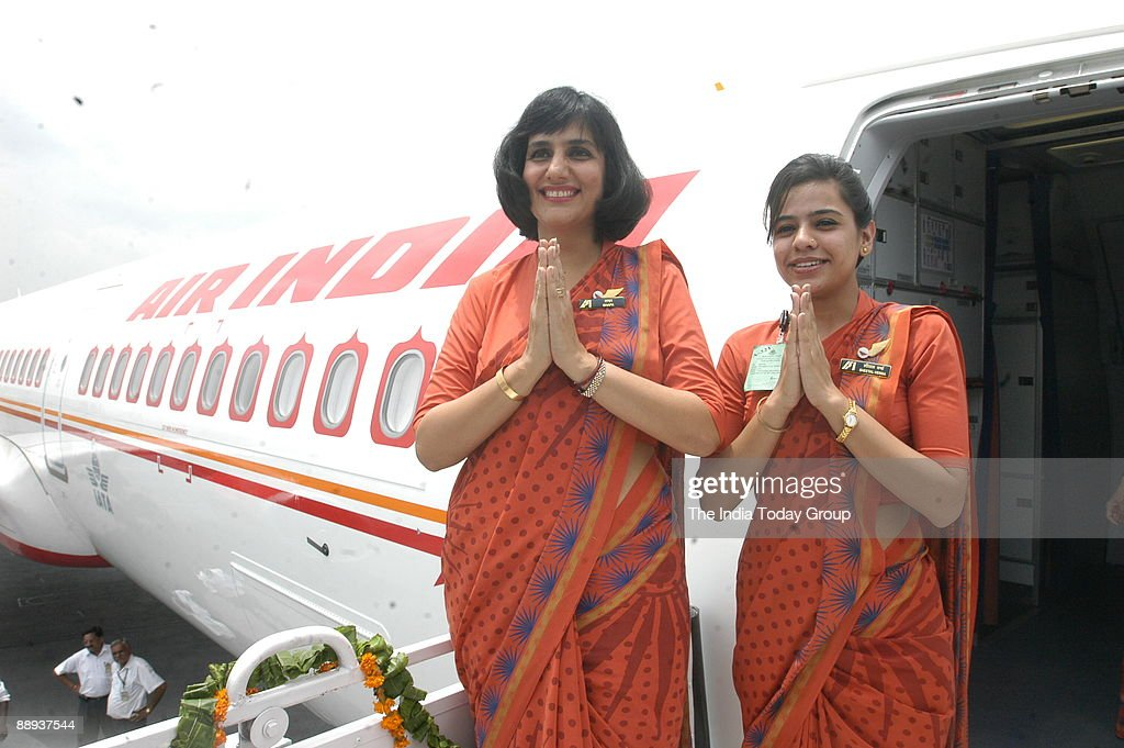 Air India air hostesses in their new uniform atop the Air India flight, during the delivery of the Boeing 737-800 VT-AXH to its own fleet at Indira Gandhi International Airport in New Delhi, India ( Air India-Express, Aeroplane, Indian Airline, Inaugurati : News Photo