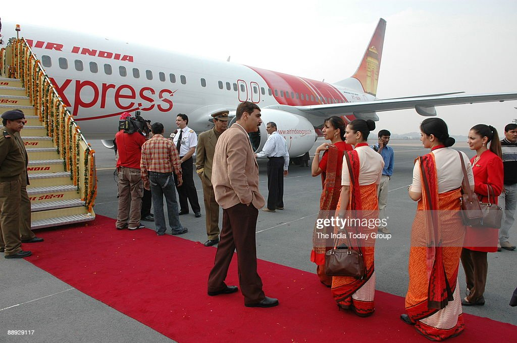 Air India air hostesses, wear their new uniform atop the Air India flight, during the delivery of the Boeing 737-800 Commercial Jetliner for Air India in New Delhi, 06 November 2006. Air India celebrated the delivery of the first of its planned order of 6 : News Photo