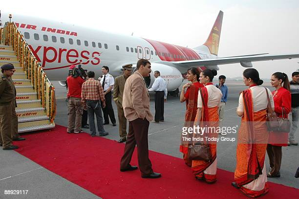 Air India air hostesses wear their new uniform atop the Air India flight during the delivery of the Boeing 737800 Commercial Jetliner for Air India...