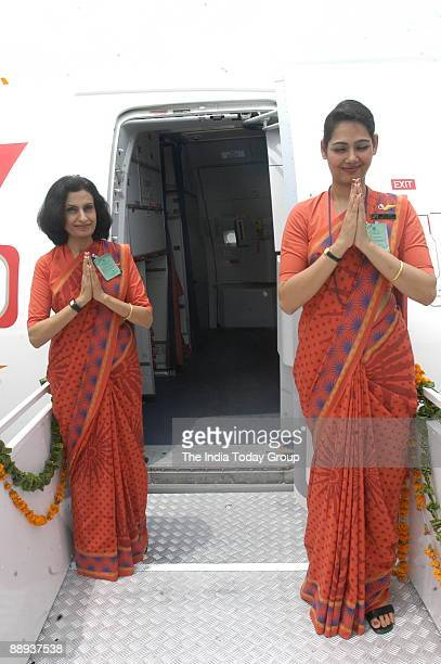 Air India air hostesses wear their new uniform atop the Air India flight during the delivery of the Boeing 737800 VTAXH to its own fleet at Indira...