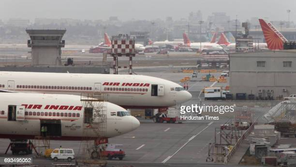 Air India aircrafts are seen parked on the tarmac of the international airport in Mumbai Air India on April 28th sought a court order against...