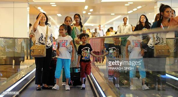 Air India passengers on a flight from New York walk on a travelator as they arrive at terminal T3 of Indira Gandhi International airport in New Delhi...
