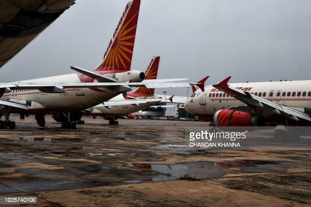 Air India planes are kept in the tarmac at the Indira Gandhi International Airport in New Delhi on September 1 2018 Bargainbasement fares high oil...