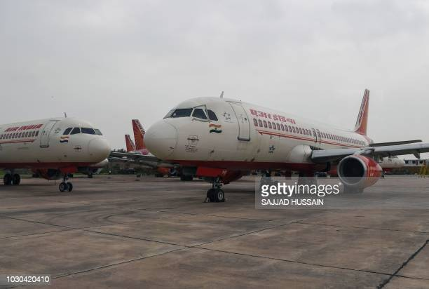 Air India planes are pictured at Indira Gandhi International Airport in New Delhi on September 10 2018