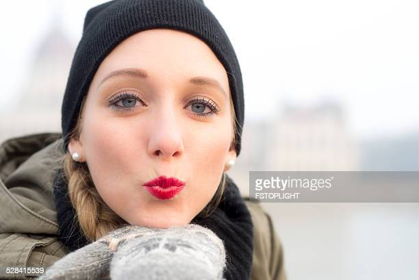 Air kiss from young woman