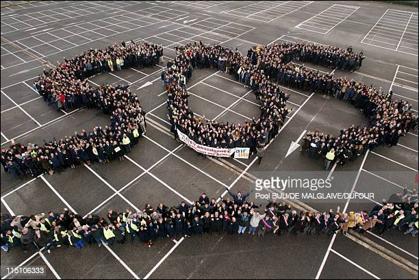 Air Liberte employees send an SOS in Orly France on February 10 2002