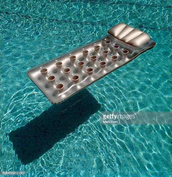 Air matress floating in swimming pool