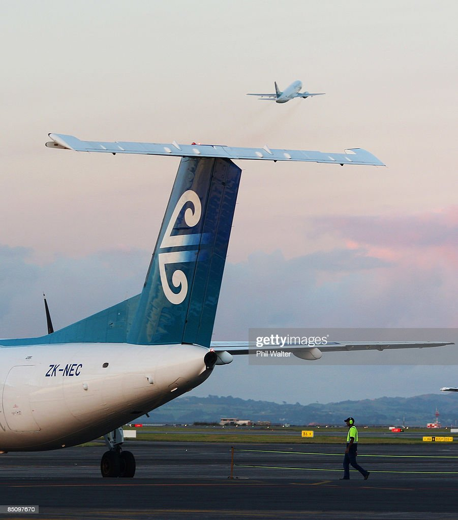 Air New Zealand aircraft on the runway at Auckland International Airport at dawn on February 26, 2009 in Auckland, New Zealand. Air New Zealand today announced their half year earnings which have dropped 84 percent to $26 million for the six-month period to the end of 2008.