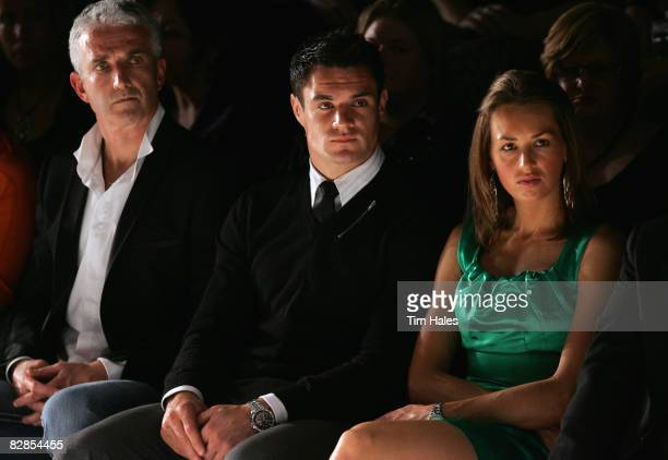 Air New Zealand CEO Rob Fyffe New Zealand All Blacks player Dan Carter and Honor Dillon watch designs on the catwalk by Trelise Cooper on the second...