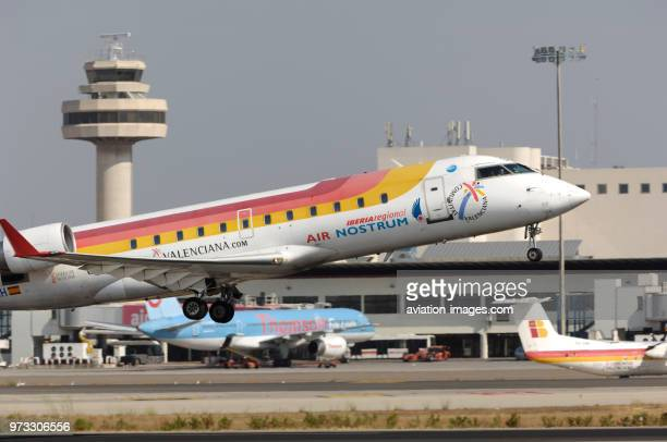 Air Nostrum Bombardier CRJ-200ER taking-off from Palma International with thomsonfly Boeing 757 and DHC-8 Q300 parked at the terminal, air-traffic...