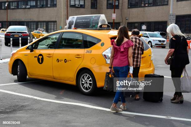 Air passengers arriving at LaGuardia Airport in New York New York board a taxi at the terminal