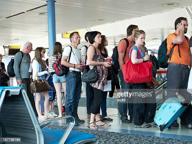 Air passengers queuing at the gate