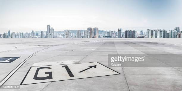 air plane concrete platform with xiamen city as background - environmental signs and symbols stock pictures, royalty-free photos & images