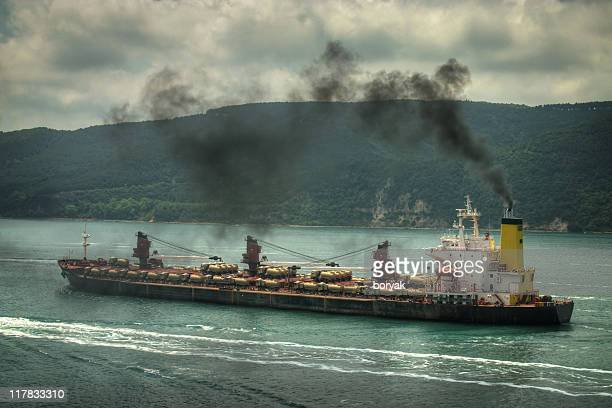 air polluting ship - ship funnel stock photos and pictures
