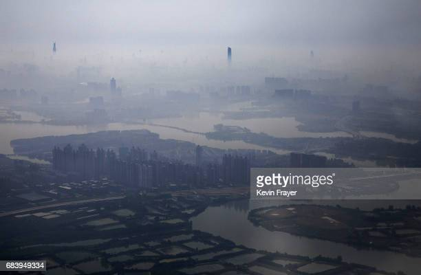 Air pollution and fog is seen on May 14 2017 over the steel city of Wuhan on the Yangtze River in Hubei province China
