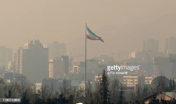 Air pollution covers the Iranian capital Tehran on December 23, 2019. - Schools in Iran's Tehran province have been ordered shut until due to severe...
